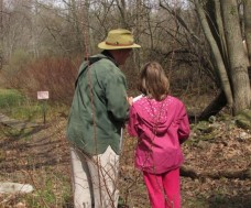 Gene Huggins inspires the next generation of birders. Photo by Donna Sponn.